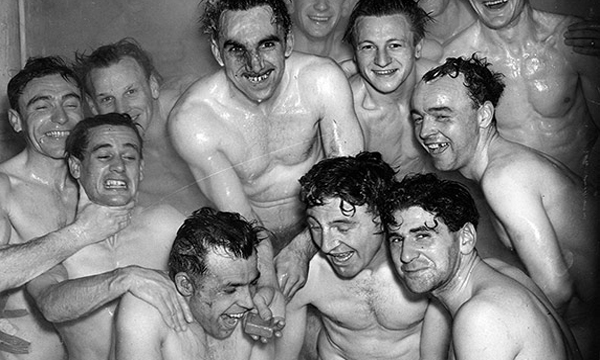 Members of the Brentford football team in the bath after a training session