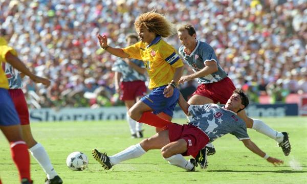 USA's Tab Ramos tackles Colombia's Carlos Valderrama